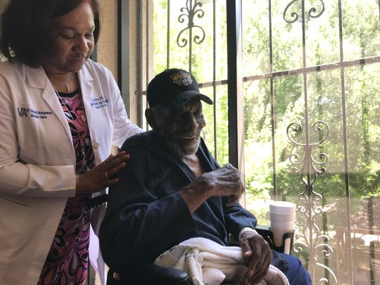 """Lisa Bruce, chief nurse for long-term care at the G.V. (Sonny) Montgomery VA Medical Center, greets one of the residents, Ananias Catchings. Of the VA nursing home, Catchings said, """"it's home. To me it is."""""""
