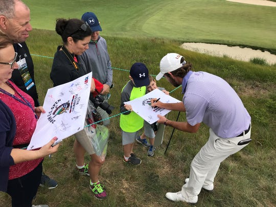 Philip Barbaree Jr. signs autographs during a practice round for the 2018 U.S. Open.
