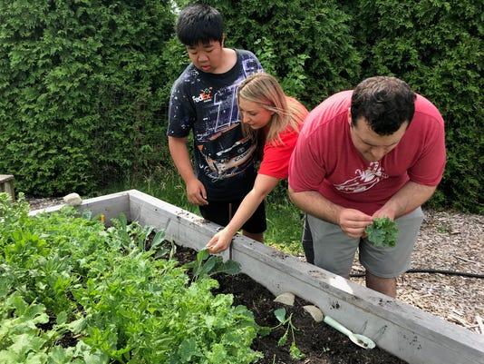 kids center clients work in garden