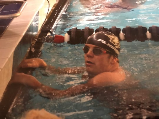 Despite his life-and-death health scare during 2016-17, Kyle Proffitt got back to doing what he loves -- swimming for the Plymouth Wildcats.