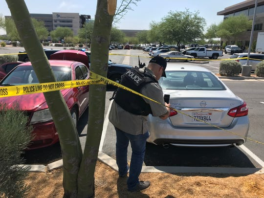 Gilbert police said a man fired a shot into the air and then pointed the gun to his head outside Banner Gateway Medical Center.