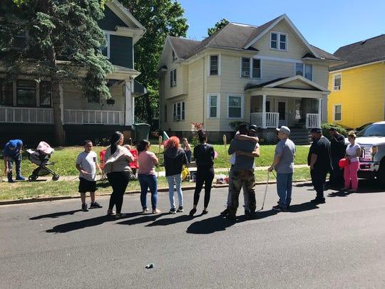 Friends and family embrace on Randolph Street on Thursday