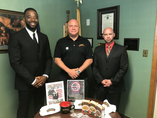 Courtney Johnson, left, and Dan Jacoby, right, of Nutley Township's Veterans Bureau, flank Joseph Hagan of the Eatontown-based Gallant Brands.