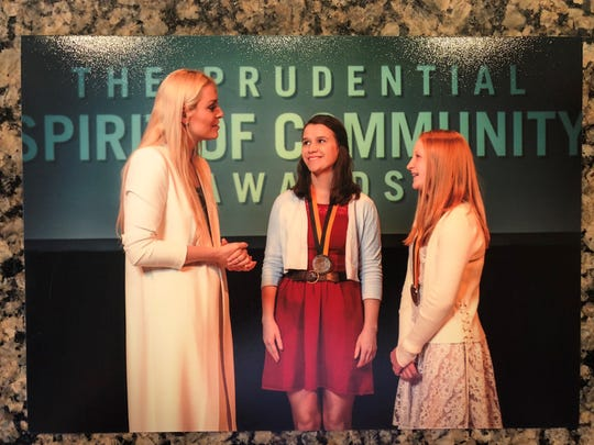 Maddie Johnson, right, meets famed Olympic skier Lindsey Vonn, left, at the Prudential Spirit of Community Award banquet in Washington D.C.