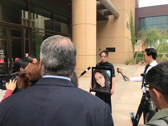 Katherine Xu addresses the media after a judge announced