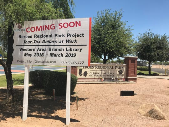 A sign advertises the future Heroes Regional Park Library in Glendale.