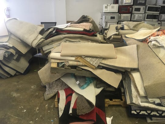 Rugs and microwaves left behind when students left
