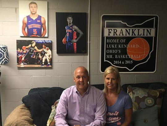 Mark and Jennifer Kennard pose in the basement of their