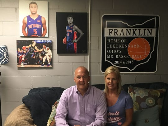 Mark and Jennifer Kennard pose in the basement of their Franklin, Ohio, home where Luke crashed when he's in town. The room also doubles as a shrine for Franklin's most famous son.