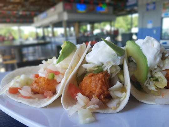 A plate of fish tacos from KC's Marina Pointe arrives