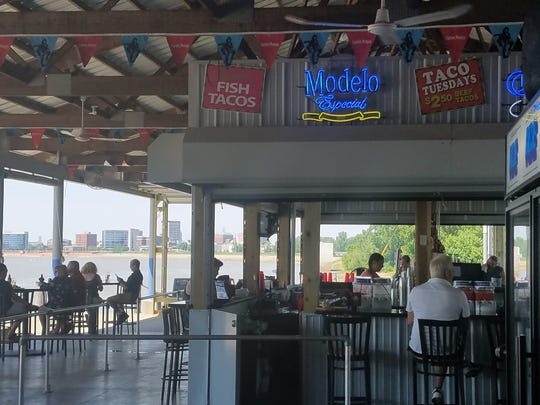 KC's Marina Pointe keeps getting bigger. The outdoor seating area with a new bar overlooks the river with a great view of Downtown Evansville.