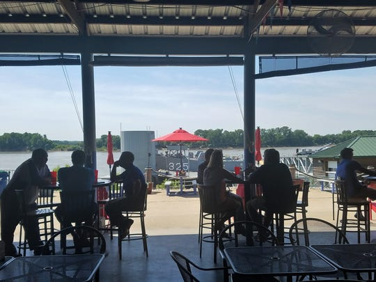 Diners at KC's Marina Pointe have a view of LST 325.
