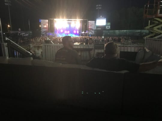 Concert-goers have a conversation on the lower concourse of The Ballpark at Jackson while waiting for Jake Owen to headline the concert on Friday.