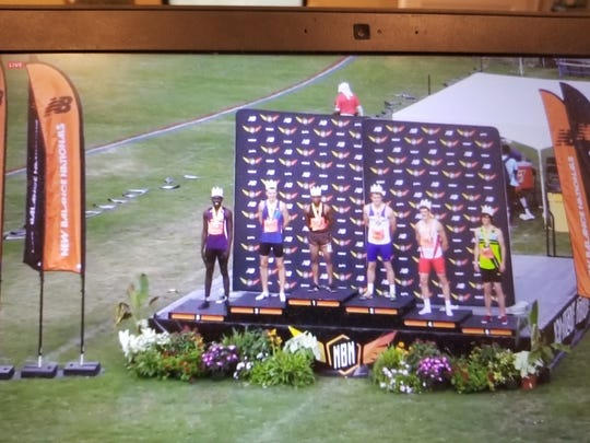 Luis Peralta of Passaic (3rd from left) on the awards podium after winning the 800 National Championship at the New Balance Nationals in Greensboro, N.C.