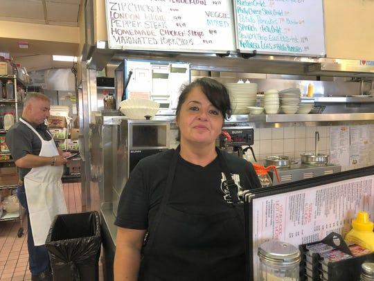 DeeDee Lulgjuraj, a waitress at the Double Ee Restaurant