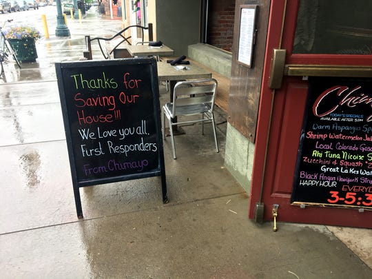 A sign outside a restaurant Sunday in downtown Durango, Colorado, thanks firefighters for their work on the nearby 416 Fire.