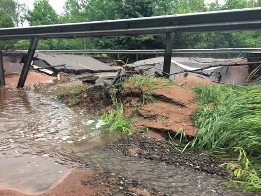 Flood damage on M-26 north of Dollar Bay