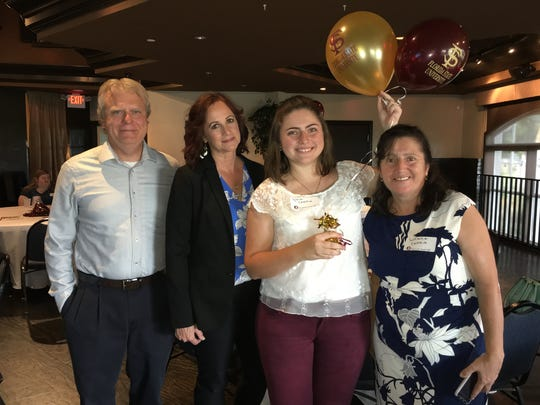Sylvia Canko (second from the left) receives The Jordan Ashley Gutheim Scholarship from Jordan's parents Greg (far left) and Lorraine (second from the left) Gutheim.