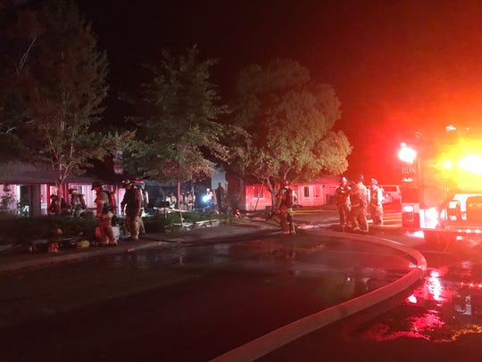 Redding firefighters do mop up after a garage fire