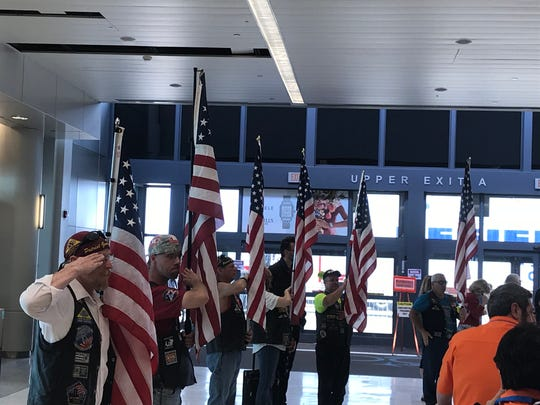 Honor Guards greet Honor Flight vets at Rochester International Airport