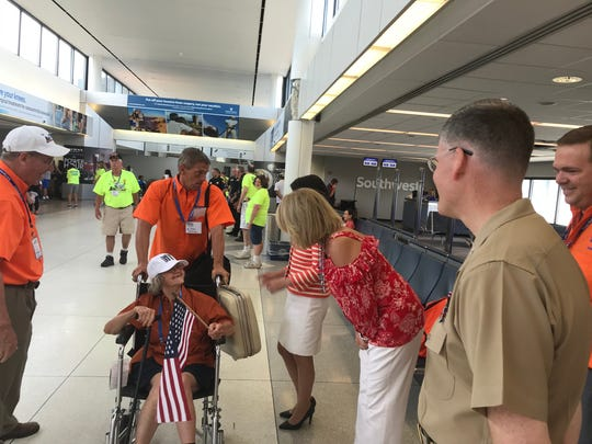 Jean Hummel, a WWII vet, arrives home from Honor Flight