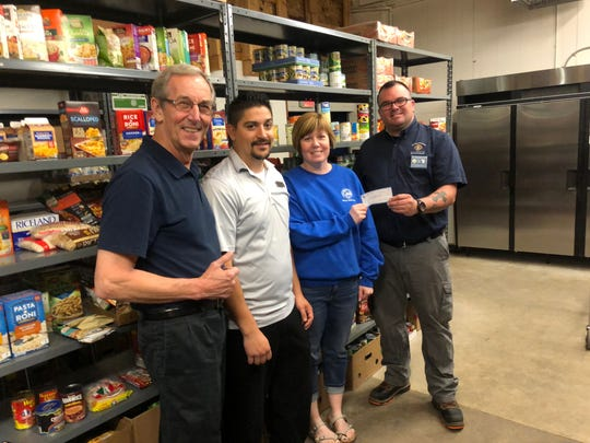 The William P. Stephani Council 710 Knights of Columbus recently raised $1,093 for the St. Vincent de Paul food pantry during a pancake breakfast at Applebee's. Pictured, from left: Ron VonDrachek,past Grand Knight Knights of Columbus;Manuel Renteria, general manager at Applebee's;Maria Moran, manager at St. Vincent de Paul; and Peyton Hagerstrom, current Grand Knight Knights of Columbus.