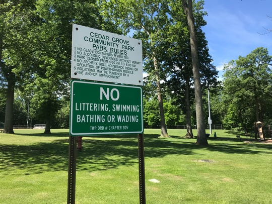 A sign in Cedar Grove's Community Park warns people