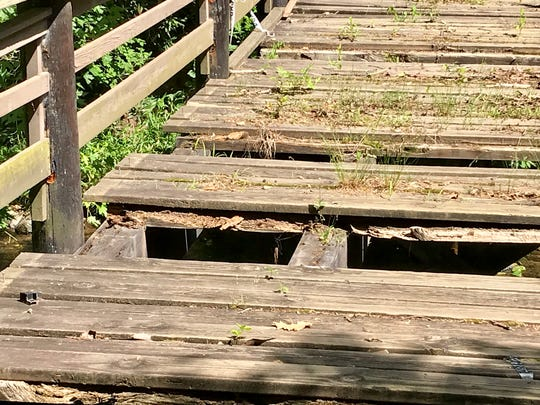 The old foot bridge at the Botanical Gardens at Asheville has begun to rot, necessitating replacement.