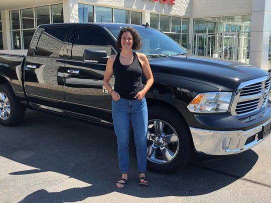 Melissa Foust stands by her new Dodge pickup that Jackson dealer Wes Lutz got specifically for her at Manheim Detroit Auction.