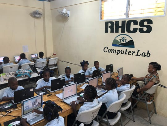 Students at the Respire Haiti school work on laptop