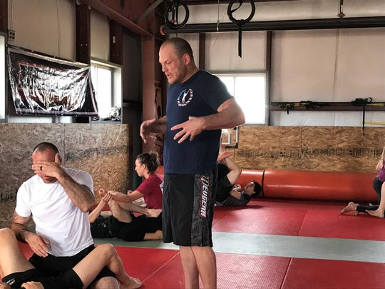 Kelly Anundson trains some young fighters at his gym, Combat Sports and Fitness, on Monday in Reno.