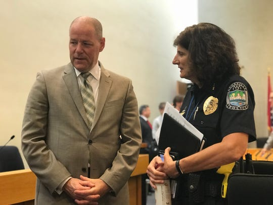 Knoxville Police Chief David Rausch and deputy chief Eve Thomas talk after the Knoxville City Council meeting on Tuesday, June 19. Rausch was named the next director of the Tennessee Bureau of Investigation on Monday.