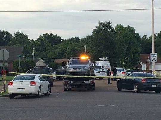 Memphis police tape off the scene where two were shot