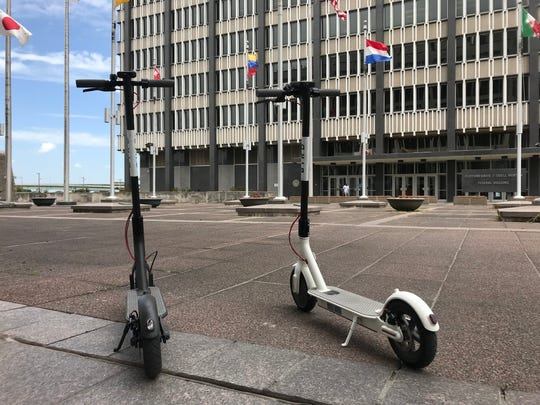 Bird electric scooters await riders in Memphis' Civic Plaza next to City Hall on June 19, 2018. Bird rolled out 200 scooters in the city three days before.