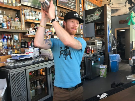 BelAir Cantina bartender Ryan Blundon gives the ingredients for a margarita a good, long shake.