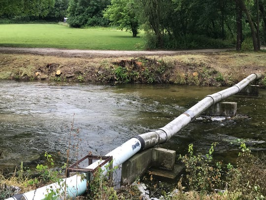 A pipe that connects Lake Nagawicka to the Delafield Fish Hatchery pond runs over the Bark River. One of the objectives of the restoration project will be to relocate the pipe below the river.