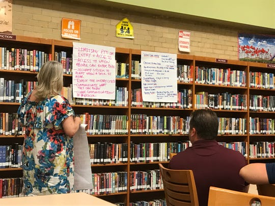 Parent Blaire Rzempoluch presents her focus group's school security priorities on June 19, 2018, during a community meeting, hosted by the Nutley Board of Education.