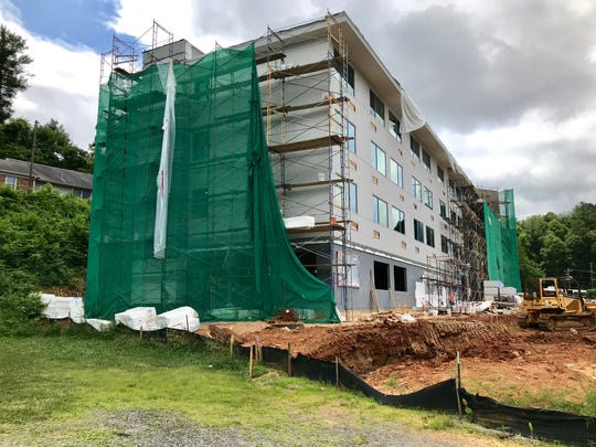 The Asheville-Buncombe area will have more than 1,900 new hotel rooms come online in 2018-19, including 72 at this new Glo Hotel in East Asheville, which is under construction.