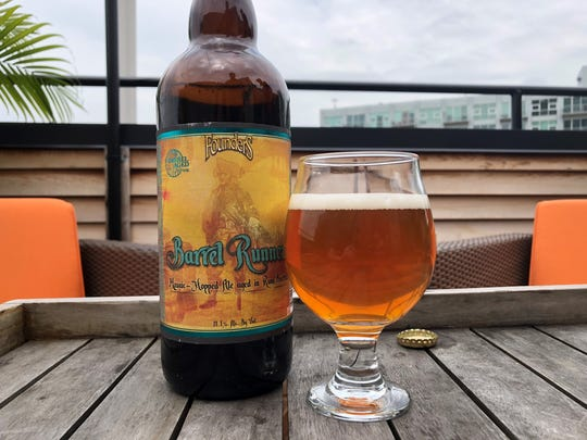Barrel Runner (11.1% alcohol by volume) rum-barrel-aged imperial IPA from Founders Brewing Co., pictured here on the rooftop patio of Hopcat Royal Oak, is to be available June through August. 2018.