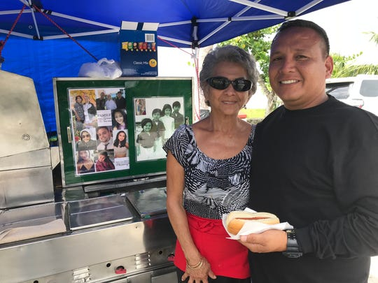 "Ken Lape (right) has been a regular at ""Auntie Evelyn's"" hot dog stand since the 1970s."