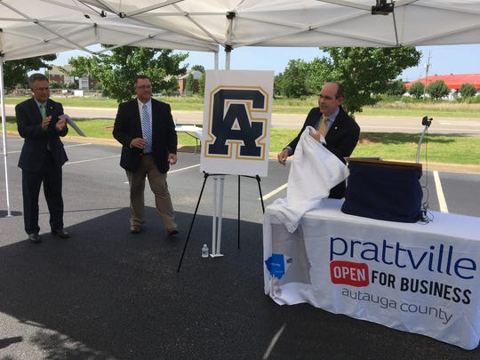 From left, Prattville Mayor Bill Gillespie, Kyle Glover of the Prattville Area Chamber of Commerce, and Alabama Sen. Clyde Chambliss unveil plans for community college classes at Pratt's Mill Center.