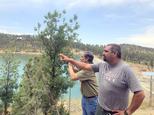 Habitat specialist John Montoya and wildlife biologist Larry Cordova with the Smokey Bear Ranger District of the Lincoln National Forest spot the osprey pair on the nesting platform.