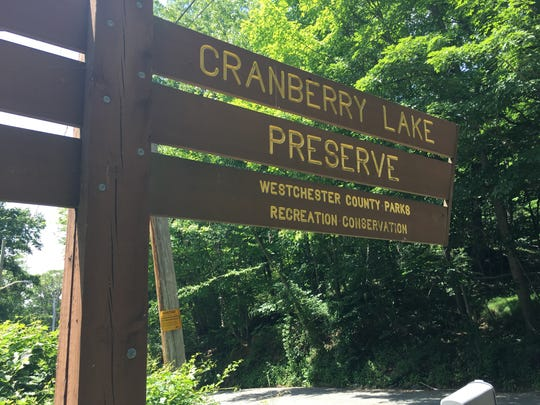 A sign at the entrance of Cranberry Lake Preserve. The signs formerly would have the name of the sitting county executive, but a law signed June 20, 2018 ends that practice.