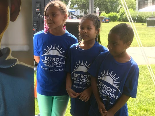 Students from Nolan Elementary-Middle School in Detroit model new t-shirts Thursday that show the new logo and tagline for the Detroit Public Schools Community District.