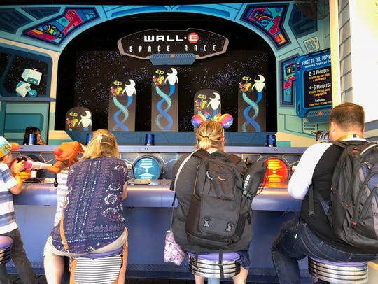 Disneyland goers play Wall-E's Space Race on June 21,