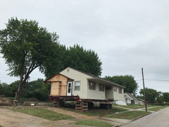 A house on Elmwood Avenue near LifeScape is raised up on wheels. The nonprofit wants to vacate homes in the area to build a parking lot.