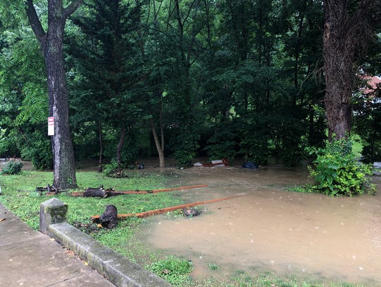 A hard rain causes flood conditions around Lewis Creek.