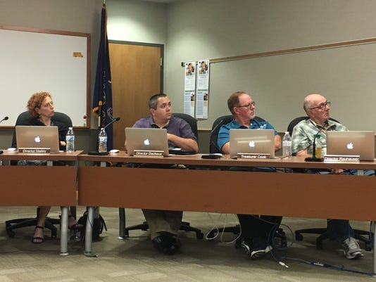 Dover Area School Board members consider bids for the $65 million high school development project