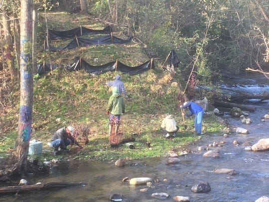 Three Vanguard Chapter Michigan Trout Unlimited members