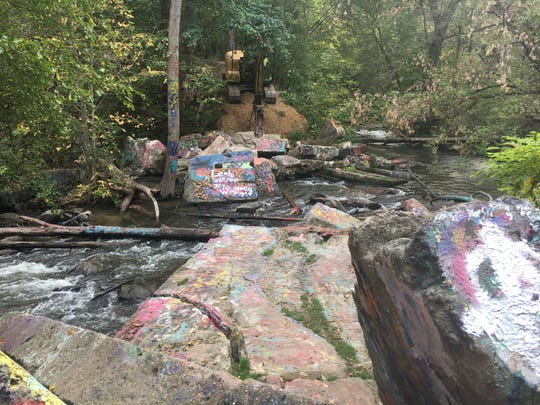 Native plants were placed at Kern and Clarkston roads, where large graffiti-covered slabs of concrete – the remnants of the Rudds Mill Dam – had been removed through a partnership that included the Michigan Department of Environmental Quality and the Michigan Department of Natural Resources.